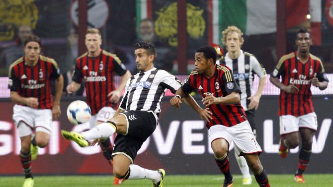 AC Milan's Robinho fights for the ball with Udinese's Pinzi during their Italian Serie A soccer match in Milan