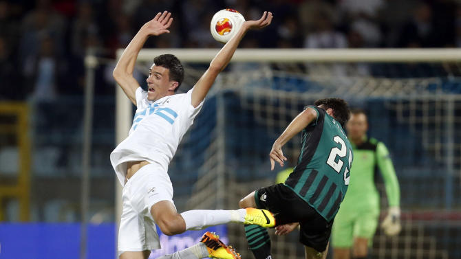 Betis' Jordi, right, is challenged by Rijeka's Ivan Krstanovic during their group I Europa League first round second leg soccer match, at Kantrida stadium in Rijeka, Croatia, Thursday, Oct. 3, 2013