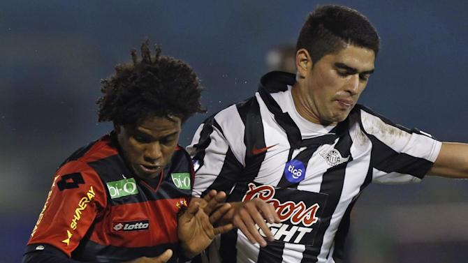 Rithely, of Brazil's Sport Recife, left, fights for the ball with Luis Amarilla, of Paraguay's Libertad, at a Copa Sudamericana soccer game in Asuncion, Paraguay, Wednesday, Sept. 25, 2013