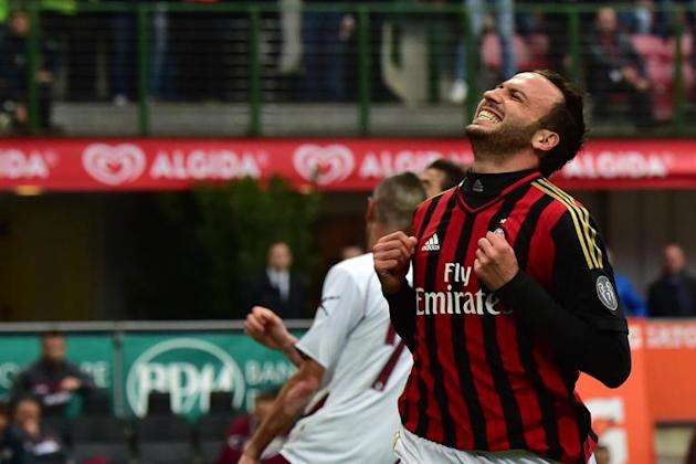 AC Milan's forward Giampaolo Pazzini celebrates after scoring during an Italian Serie A football match against Livorno at San Siro Stadium in Milan on April 19, 2014