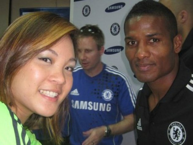 Glecy Buntelle Tan posing for a picture with her favourite player Florent Malouda. (Phtoto courtesy of Glecy Buntelle Tan)