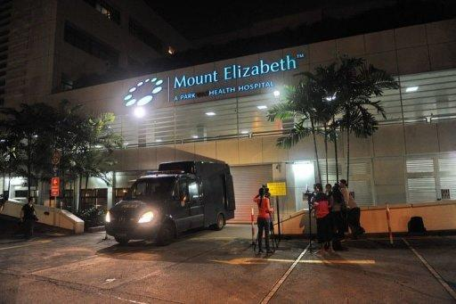 A police morgue vehicle is parked in front of the Mount Elizabeth hospital in Singapore on December 29, 2012, to retrieve the dead body of the Indian gang-rape victim. The 23-year-old woman died Saturday in Singapore after suffering severe organ failure, the hospital treating her said, in a case that sparked widespread street protests over violence against women.