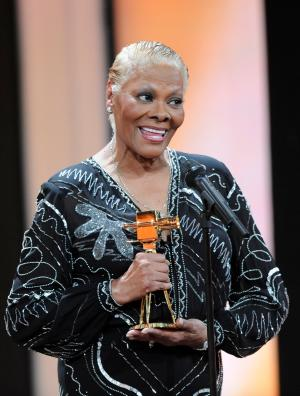 """FILE - In a Saturday, Feb. 4, 2012 file photo, singer Dionne Warwick holds her trophy for """"Musical Lifetime Achievement"""" during the 47th Golden Camera award ceremony in Berlin. Warwick has postponed a Valentine's Day concert at at The Palace Theater in Greensburg, western Pennsylvania after the death of her cousin Whitney Houston. Warwick's concert at The Palace Theater will instead be held March 2. Tickets for Tuesday night's concert will be honored for the new show.    (AP Photo/Maurizio Gambarini, pool, File)"""