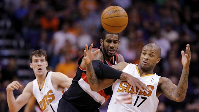 Phoenix Suns' P.J. Tucker (17) is fouled by Portland Trail Blazers' LaMarcus Aldredge as Suns' Goran Dragic, of Slovenia, rear, watches during the second half of an NBA basketball game, Wednesday, Nov. 27, 2013, in Phoenix