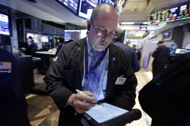 Trader Jeffrey Vazquez works on the floor of the New York Stock Exchange Monday, April 20, 2015. U.S. stocks are opening higher as more big companies turn in healthy financial results for the first qu
