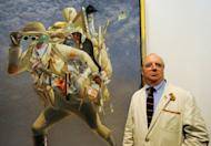 Australian artist Tim Storrier stands beside his painting 'The Histrionic Wayfarer (after Bosch)' after winning the 91st Archibald Prize at the Art Gallery of NSW in Sydney, on March 30. The Archibald Prize is one of Australia's oldest and most prestigious art prizes