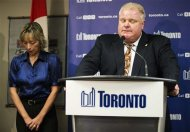 Toronto Mayor Rob Ford speaks at a news conference with his wife Renata (L) at City Hall in Toronto, November 14, 2013. REUTERS/Mark Blinch