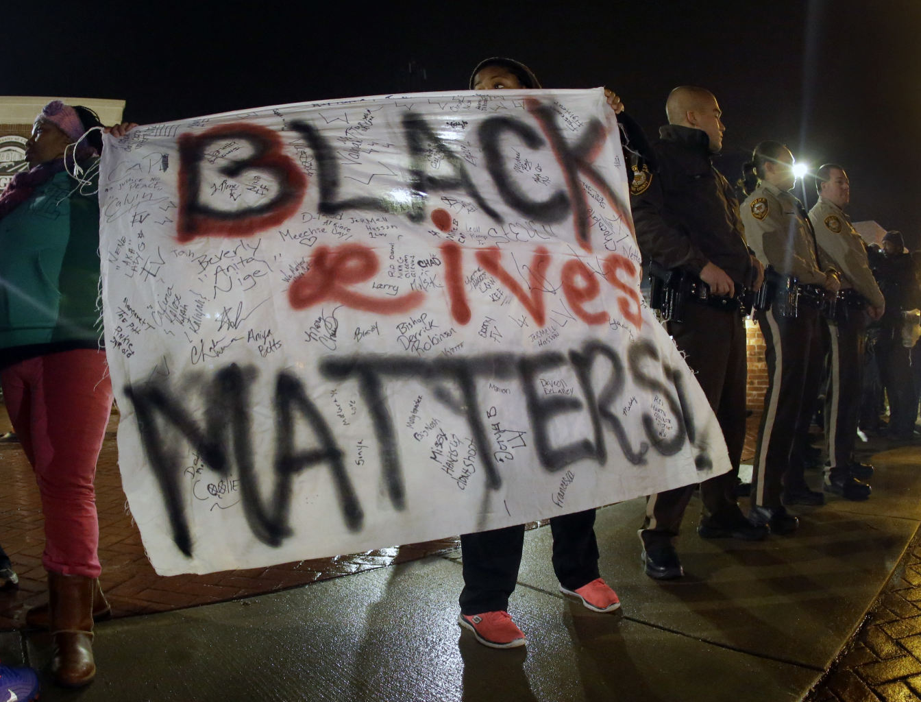 Crowd angry about the august shooting of unarmed black teenager by a