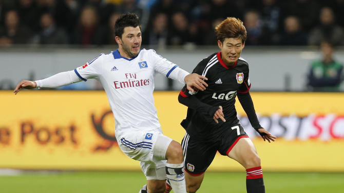 Leverkusen's Son Heung-min  of South Korea, right, is fouled by Hamburg's Tolgay Arslan during the German first division Bundesliga soccer match between Bayer Leverkusen and Hamburg SV in Leverkusen, Germany, Saturday, Nov. 9, 2013