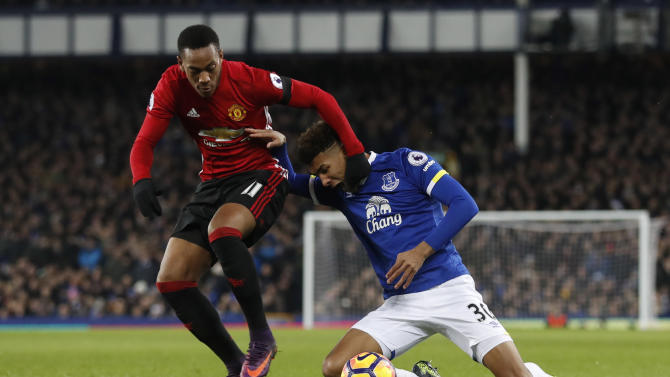 Manchester United's Anthony Martial in action with Everton's Mason Holgate