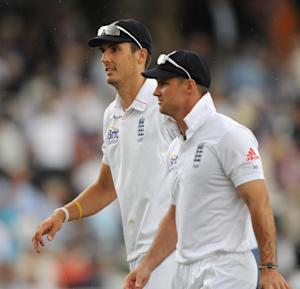 Steven Finn, left, has revealed his disappointment after Andrew Strauss, right, stepped down as England captain