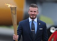 Footballer David Beckham carries the Olympic torch during the relay in May. Beckham, the former England captain, revealed Thursday he had not been picked for Great Britain's Olympic football squad. Regarded as a potential skipper of the side, Beckham confirmed in a statement he had not made the final 18-man squad as one of coach Stuart Pearce's three over-age players