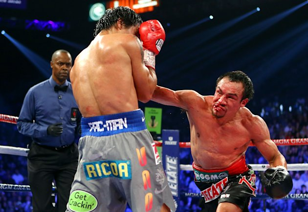 LAS VEGAS, NV - DECEMBER 08: (R-L) Juan Manuel Marquez lands a right to the face of Manny Pacquiao during their welterweight bout at the MGM Grand Garden Arena on December 8, 2012 in Las Vegas, Nevada. (Photo by Al Bello/Getty Images)