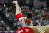 South Korea's gymnast Yang Hak Seon performs to win gold in the men's vault final of the artistic gymnastics event of the London Olympic Games on August 6, 2012 at the 02 North Greenwich Arena in London. AFP PHOTO / THOMAS COEX