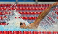 Michael Phelps swims to a first place finish in Heat 12 of the men's 200m Individual Medley on day five of the 2012 US Olympic Team Trials