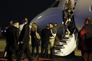 French President Francois Hollande (C) welcomes members of the Moulin-Fournier family arriving from Yaounde, at Orly airport, near Paris, on April 20, 2013. Hollande welcomed the family of seven back to France as they flew into Paris after two months in the hands of Nigeria's Islamist militants