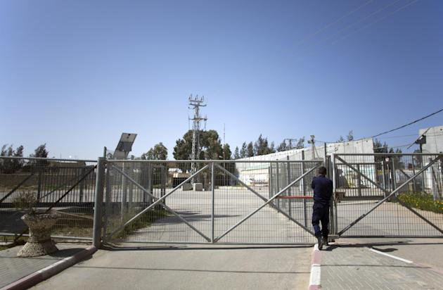 A Palestinian Hamas police officer stands next to the last gate of the Palestinian side of the border with Egypt in the southern Gaza Strip, Friday, Feb. 27, 2015. With the war-battered Gaza Strip's b
