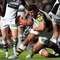 Harlequins' Nick Easter is tackled by Leicester Tigers' Toby Flood, left, in a match where the number eight impressed