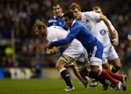 England flanker Chris Robshaw (L) is tackled by wing Benjamin Fall during the Six Nations clash at Twickenham on February 23, 2013. England saw off a vastly improved France 23-13