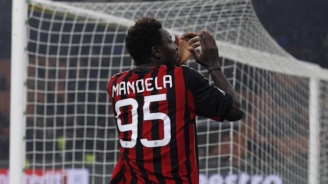 AC Milan's Sulley Muntari wears a jersey reading Mandela as he applauds supporters at the end of a Champions League, Group H, soccer match between AC Milan and Ajax at the San Siro stadium, in Milan, Italy, Wednesday, Dec.11, 2013. AC Milan is through to the Champions League last 16 after holding Ajax to a goalless draw despite playing most of the match with 10 men after captain Riccardo Montolivo was sent off