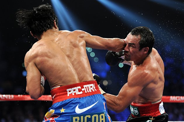 LAS VEGAS, NV - NOVEMBER 12: (R-L) Juan Manuel Marquez prepares to throw a right at Manny Pacquiao during the WBO world welterweight title fight at the MGM Grand Garden Arena on November 12, 2011 in Las Vegas, Nevada. (Photo by Harry How/Getty Images)