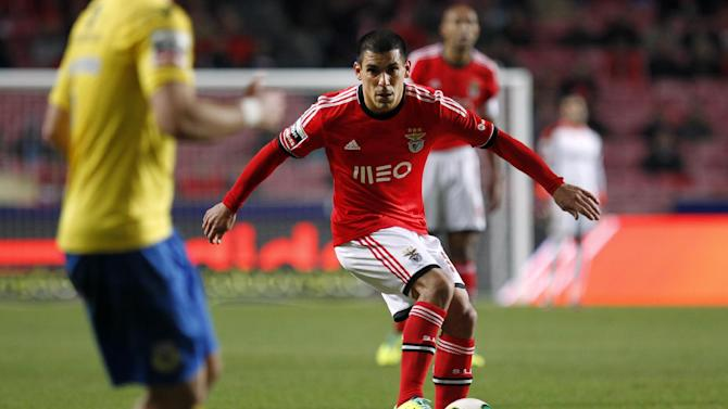 Benfica's Maxi Pereira, from Uruguay, controls the ball during a Portuguese league soccer match between Benfica and Arouca at Benfica's Luz stadium in Lisbon, Friday, Dec. 6, 2013. The match ended in a 2-2 draw
