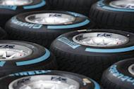 "Pirelli ""Full Wet"" Formula One tyres are pictured in the pit ahead of the Singapore F1 Grand Prix September 18, 2013. REUTERS/Tim Chong"