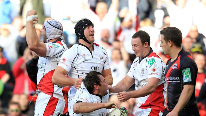 Ulster's Declan Fitzpatrick (C) celebrates with teammates after scoring a try against Edinburgh during the semi-final European Rugby match at the Aviva Stadium in Dublin, Ireland on April 28, 2012. AFP PHOTO/ Peter MuhlyPETER MUHLY/AFP/GettyImages