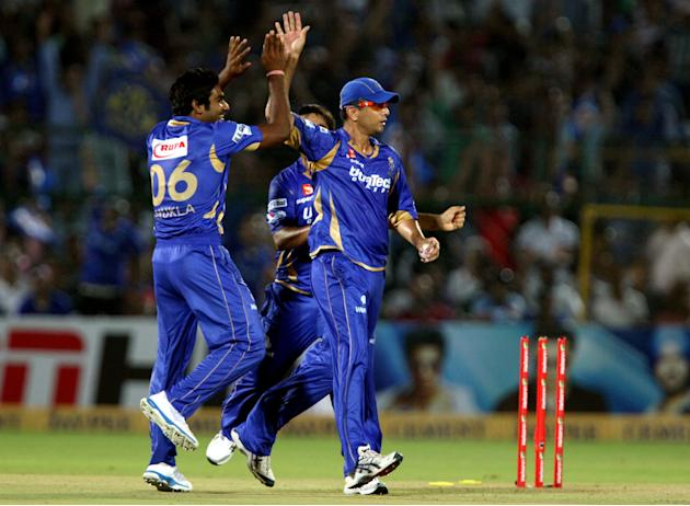 Rajasthan Royals captian Rahul Dravid and bowler Rahul Shukla celebrates fall of wicket during the CLT20 match against Mumbai Indians at Sawai Mansingh Stadium, Jaipur on Sept. 21, 2013. (Photo: IANS)