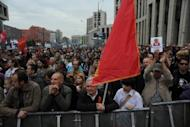 Opposition activists and supporters take part in an anti-Putin protest in central Moscow on September 15. Russian opposition leaders argued Sunday over the turnout and success of the latest rally defying President Vladimir Putin, after tens of thousands marched through central Moscow.