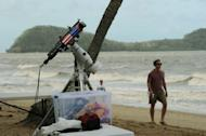 Equipment to watch the solar eclipse is set up early on the beach at Palm Cove in tropical north Queensland. Scientists were studying the effects of the eclipse on the marine life of the Great Barrier Reef and Queensland's rainforest birds and animals while psychologists were monitoring the impact on humans