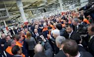 Chinese Prime Minister Wen Jiabao (C), is surrounded by Volvo employees and media during his visit to the Volvo car factory in Gothenburg. Chinese automaker Geely bought Volvo Cars from US carmaker Ford in 2010