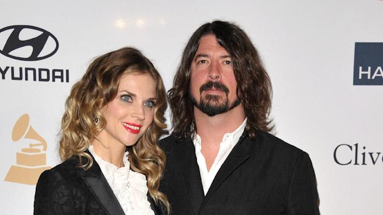 Recording artist Dave Grohl, right, and Jordyn Blum arrive at the Clive Davis Pre-GRAMMY Gala on Saturday, Feb. 9, 2013 in Beverly Hills, Calif. (Photo by John Shearer/Invision/AP)
