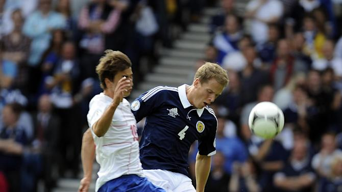 Scotland can take positives from their draw with Serbia, according to Christophe Berra, right