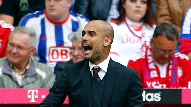 Guardiola, coach of FC Bayern Munich gestures during their German first division Bundesliga soccer match against Hertha Berlin in Munich