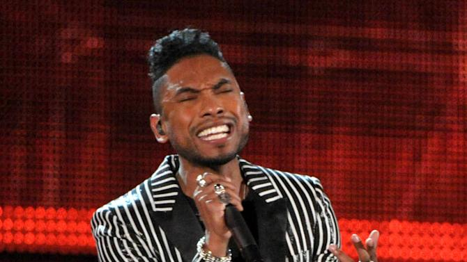 FILE - In this Feb. 10, 2013 file photo, Miguel performs at the 55th annual Grammy Awards in Los Angeles. While on his latest international tour, Los Angeles-born Miguel was happy to meet his fans with different accents. He was also hype about his fans' thrift shops. (Photo by John Shearer/Invision/AP)