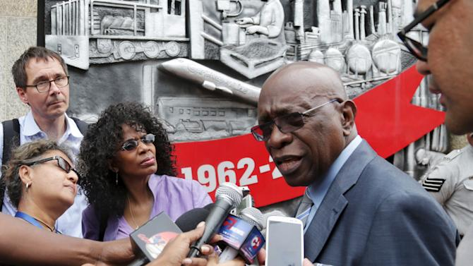 Former FIFA vice-president Jack Warner, who is a parliamentary representative for Chaguanas West, talks to journalists while arriving at the parliament building to attend a session in Port-of-Spain