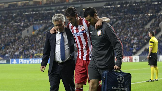 Atletico's Raul Garcia leaves the pitch with an injury during the Champions League group G soccer match between FC Porto and Atletico de Madrid Tuesday, Oct. 1, 2013, at the Dragao stadium in Porto, northern Portugal. Atletico won 2-1