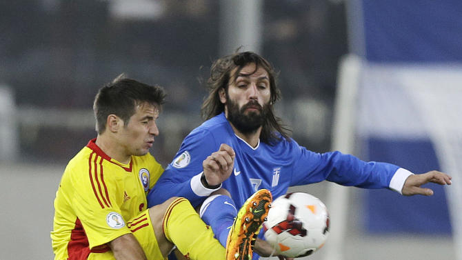 Greece's Giorgos Samaras, right, and Romania's Alexandru Matel in action during their World Cup qualifying playoff first leg soccer match at the Karaiskaki stadium in the port of Piraeus, near Athens, Friday, Nov. 15, 2013