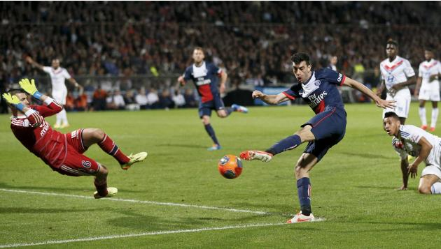 Paris St Germain Pastore tries to shoot a goal past Olympique Lyon's goalkeeper Lopes during their French Ligue 1 soccer match at the Gerland stadium in Lyon