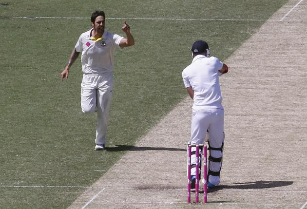 Australia's Johnson celebrates after taking the wicket of England's Anderson during the second day of the fifth Ashes cricket test at the Sydney cricket ground