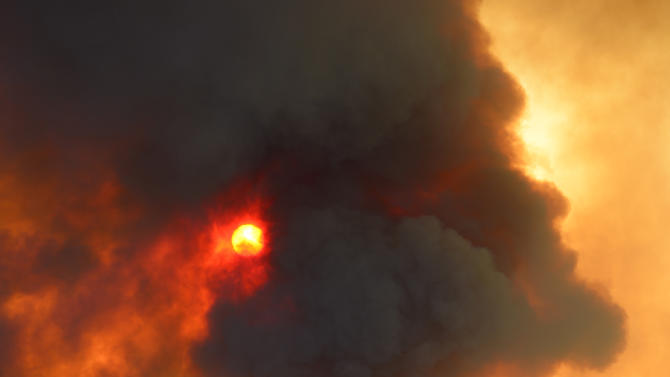 FILE - In this Thursday, May 2, 2013 file photo, smoke billows from a fire burning in Point Mugu State Park during a wildfire that burned several thousand acres in Ventura County, Calif. The jet stream's odd meanderings kicked off May 2013 with upside-down weather, including early California wildfires fueled by heat. (AP Photo/Mark J. Terrill)