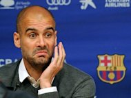 Barcelona's coach Josep Guardiola addresses a news conference in Barcelona on April 27. The club have appointed Francesc 'Tito' Vilanova as the successor to Guardiola, who announced he is leaving the club after four hugely successful years at the helm