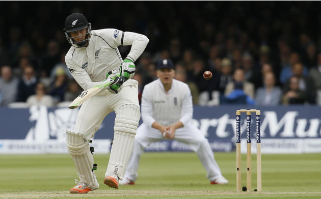 New Zealand's Martin Guptill plays a ball off the bowling of England's Mark Wood during play on the second day of the first Test match at Lord's cricket ground in London, Friday, May 22, 2