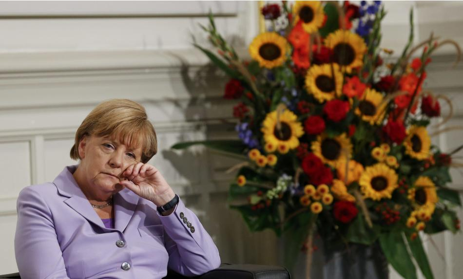 German Chancellor Merkel is listening to her laudation during the award ceremony for her honorary doctorat from the Bern University in the Swiss capital Bern
