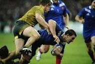 France's Louis Picamoles (C) clashes with Australian flanker Michael Hooper during the rugby union Test match at the Stade de France in Paris. France beat Australia 33-6