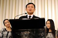 File picture of Thailand's former prime minister Thaksin Shinawatra (C) at a press conference with daughters Pinthingta (L) and Paethongtarn in Bangkok in 2008. A flight attendant has left her job with Cathay Pacific after saying on Facebook that she wanted to throw coffee over Paetongtarn, the airline said Tuesday