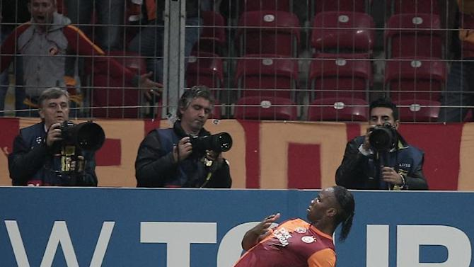 Galatasaray's Didier Drogba celebrates after scoring against FC Copenhagen during their Champions League Group B soccer match with in Istanbul, Turkey, Wednesday, Oct. 23, 2013. (AP Photo)