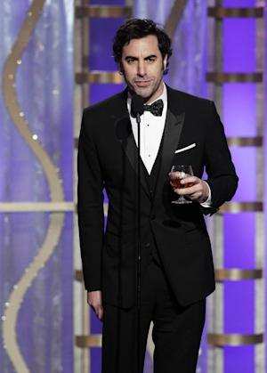 This image released by NBC shows presenter Sacha Baron Cohen during the 70th Annual Golden Globe Awards at the Beverly Hilton Hotel on Jan. 13, 2013, in Beverly Hills, Calif. (AP Photo/NBC, Paul Drinkwater)