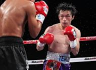 Japan's former World Boxing Council super bantamweight champion Toshiaki Nishioka, pictured here in 2011, announced his retirement Tuesday, a month after losing a world title bout to Nonito Donaire of the Philippines
